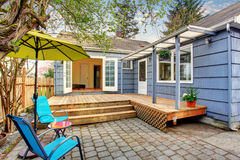 Perfect back deck with concrete patio and chairs. Stock Image
