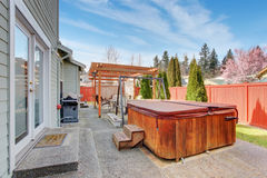 Perfect back yard with patio and jacuzzi tub. Stock Images