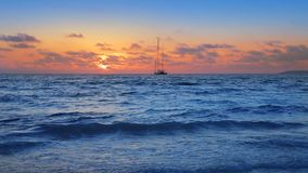 Perfect beach with sailboat in turquoise aqua color and the waves. In the shore sand stock video footage