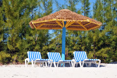 Perfect Beach Scene. Perfect Beach Resort Scene with Umbrella and Chairs Royalty Free Stock Photo