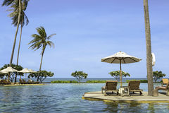 Perfect beach swimming pool with tropical resort relax. Stock Photography