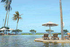 Perfect beach swimming pool with tropical resort relax. Stock Photos