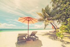 Beautiful beach. Chairs on the sandy beach near the sea. Summer holiday and vacation concept. Inspirational tropical scene. Perfect beach view. Summer holiday Stock Photography