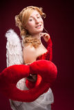 Perfect blonde angel with a red heart Stock Image