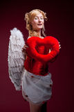 Perfect blonde angel with a red heart Stock Images