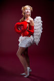 Perfect blonde angel with a red heart Stock Photography