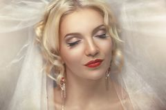 Perfect Blonde Bride Dreams Desire. Beautiful pretty smiling bride professional photo portrait photo model face red lips closed eyes enjoyment delight pleasure Royalty Free Stock Image