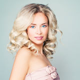Perfect Blonde Fashion Model Woman with Curly Hair Royalty Free Stock Photo