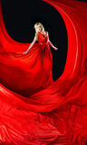 Perfect blonde in a red dress Royalty Free Stock Image