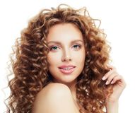 Perfect blonde woman with healthy curly hair isolated. On white stock images