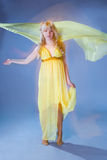 Perfect blonde in yellow dress Royalty Free Stock Photography