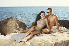 Perfect bodies couple. Posing on the coast royalty free stock image