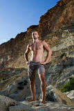 Perfect body man with naked torso. On mountains.brown trousers Stock Images