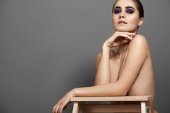 Perfect body shape. Beautiful model with fashion make-up. Sexy look Stock Photos