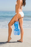 Perfect body of slim young woman posing while holding fins Stock Images