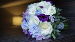 Perfect bouquet of creme luxurious roses for wedding, birthday or Valentine`s day. Black old wooden background, top view stock video footage