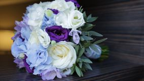 Perfect bouquet of creme luxurious roses for wedding, birthday or Valentine`s day. Black old wooden background, top view Stock Images