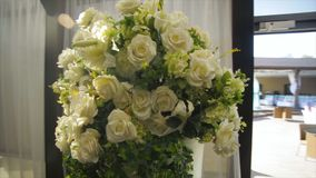 Perfect bouquet of creme luxurious roses for wedding, birthday or Valentine`s day. the bride`s bouquet on Banquet hall Royalty Free Stock Images