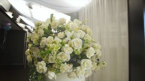 Perfect bouquet of creme luxurious roses for wedding, birthday or Valentine`s day. the bride`s bouquet on Banquet hall royalty free stock photos