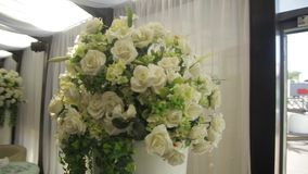Perfect bouquet of creme luxurious roses for wedding, birthday or Valentine`s day. the bride`s bouquet on Banquet hall stock video footage