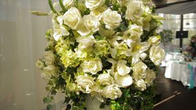 Perfect bouquet of creme luxurious roses for wedding, birthday or Valentine`s day. the bride`s bouquet on Banquet hall Royalty Free Stock Photo