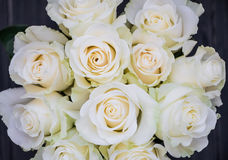Perfect bouquet of creme luxurious roses for wedding, birthday or Valentine`s day. Top view. Perfect bouquet of creme luxurious roses for wedding, birthday or royalty free stock photo
