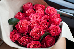 Perfect bouquet of fresh cut roses in car. Stock Image