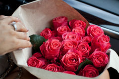 Perfect bouquet of fresh cut roses in car. Stock Photo