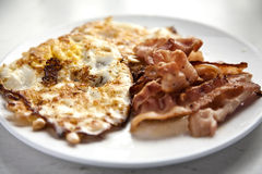 Perfect breakfast. Bacon and egg on a white plate Royalty Free Stock Image