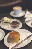 The perfect breakfast with British scones and a flat white Stock Photo
