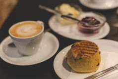 The perfect breakfast with British scones and a flat white Royalty Free Stock Photography