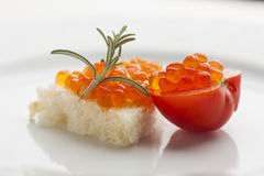 Perfect breakfast - Caviar sandwich with red cherry tomato on pl. Ate, decorated with rosemery royalty free stock image