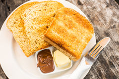 Perfect breakfast. Toast with butter and chocolate paste Stock Photos