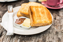 Perfect breakfast. Toast with butter and chocolate paste Stock Images