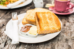 Perfect breakfast. Toast with butter and chocolate paste Stock Image
