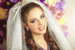 Perfect Bride Dreams Desire. Beautiful smiling bride in front of flower studio background, professional photo, fresh portrait woman girl, professional photo Royalty Free Stock Images