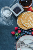 Perfect brunch, pancakes and berry fruit. With honey Royalty Free Stock Photography
