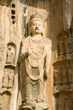 A perfect Buddha statue in the Longmen Groottoes. Located the historic city of Luoyang China. Longmen Grottoes are one of the finest examples of Chinese Royalty Free Stock Photos