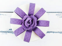 Perfect cake with lilac rose decoration on white wooden background. Beautiful cake for celebration from above on white wooden background stock photos