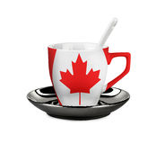 Perfect Canada Flagged coffee or tea cup with spoon. On white Royalty Free Stock Images