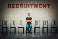 Perfect candidate for a vacant job place waiting to be hired. Young man sitting on a chair as perfect candidate for a vacant job place waiting to be hired stock photos