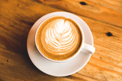 Perfect cappuccino in white cup on wood table Royalty Free Stock Image