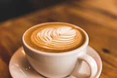 Perfect cappuccino in white cup on wood table Royalty Free Stock Photography