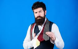 It is a perfect choice neckwear. Salesman offering a good choice of design neckties. Bearded man choosing tie from. Luxury collection, choice concept. Brutal stock photography