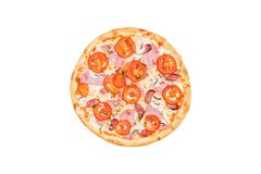 Perfect classic pizza with ham, mushrooms and tomatoes isolated on a white background. Top view royalty free stock images