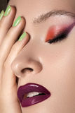 Perfect clean skin, nail polish, bright lips makeup. Beauty portrait of beautiful woman with summer colors make-up and manicure. Perfect clean and smooth skin stock photo