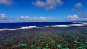 Perfect clear turquoise coral reef Pacific ocean water Tahiti island French Polynesia 4k aerial drone seascape panorama stock footage