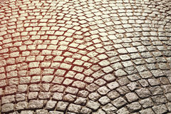 Perfect cobblestone streets of the city. Paving stone roadbed made with small stone blocks. Vintage tone stock photos