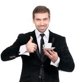 Perfect coffee. Smiling businessman holding a cup of coffee Royalty Free Stock Photo