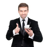 Perfect coffee. Smiling businessman holding a cup of coffee Royalty Free Stock Photography
